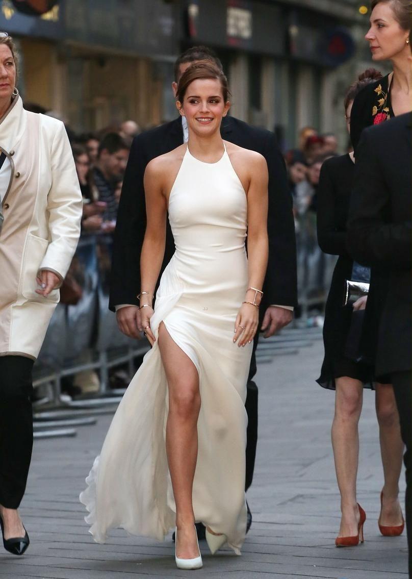 276121de70 Emma Watson looks gorgeous in this halter neck elegant minimal dress ...