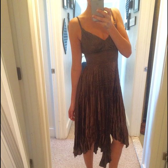 Express Dress Goldish/Brown woman's dress. Perfect for weddings or a formal event. Only worn once. In perfect condition. Waste band is stretchy and very comfortable and flattering. Express Dresses Wedding
