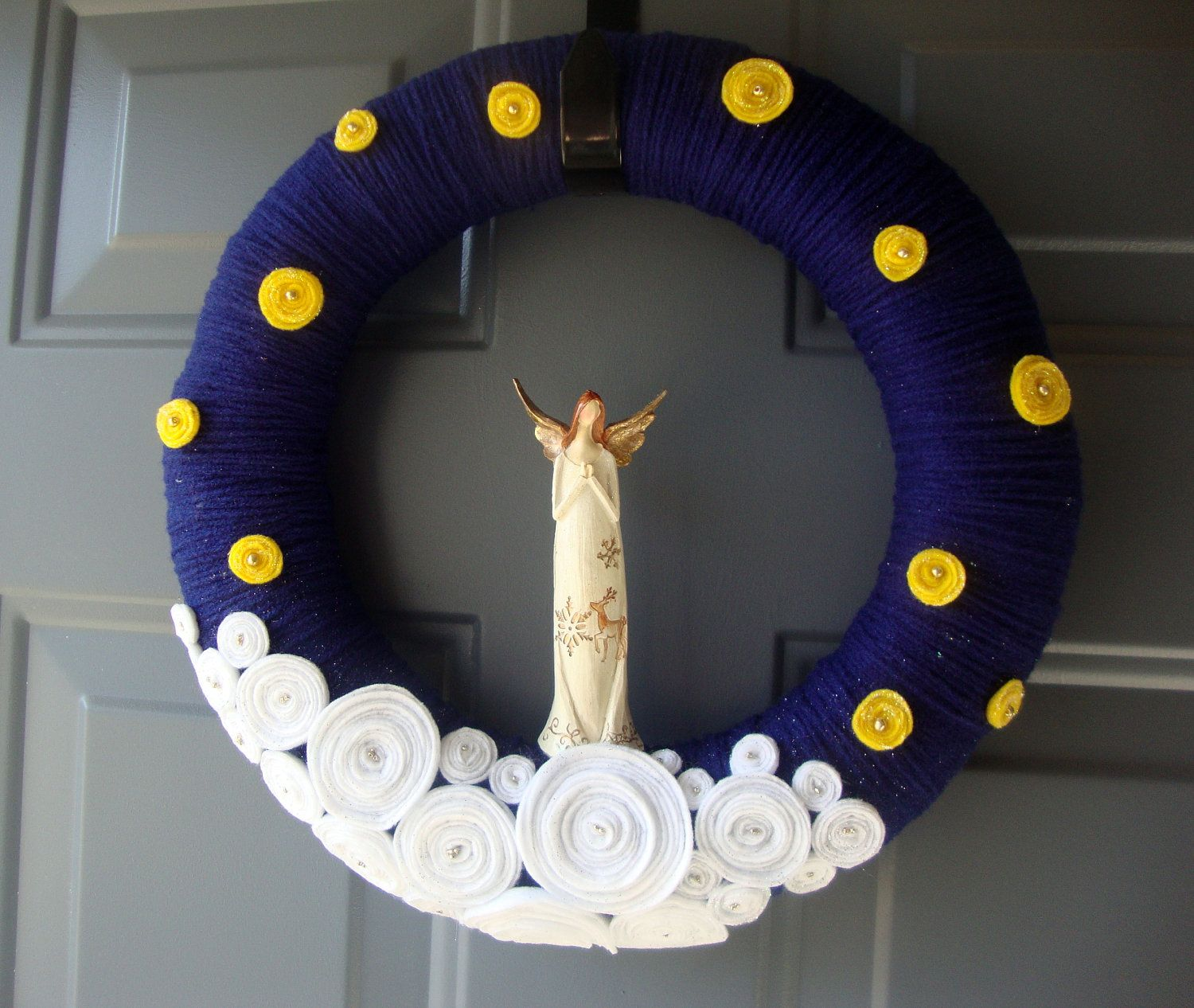 A very different Christmas wreath with an angel.