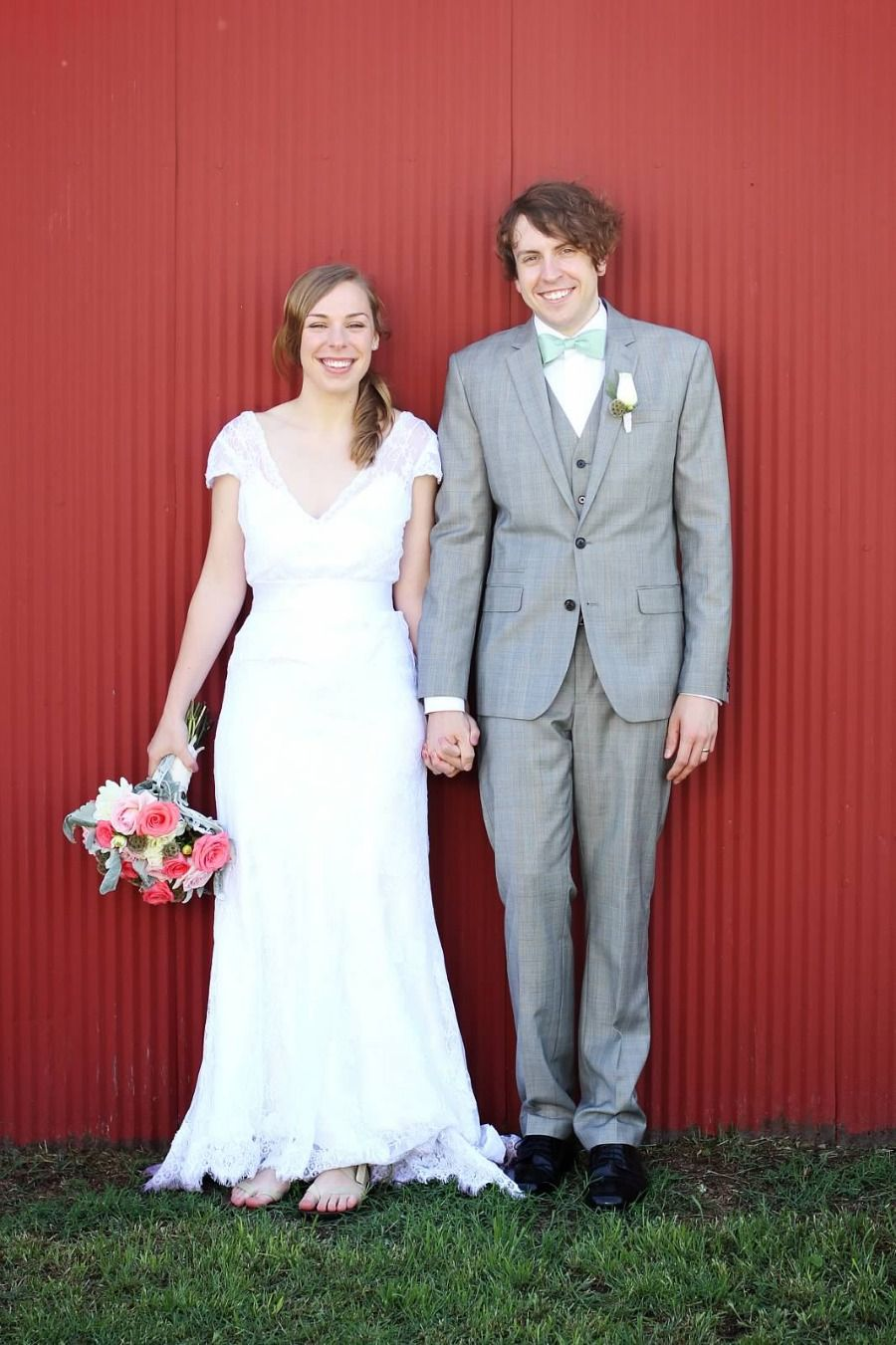 The groom is in vintage style with a light grey suite and vest with