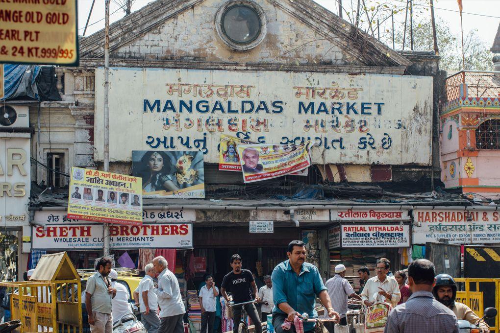 A Woman Is Ing Material At Mangaldas Market Mumbai Maharashtra India Stock