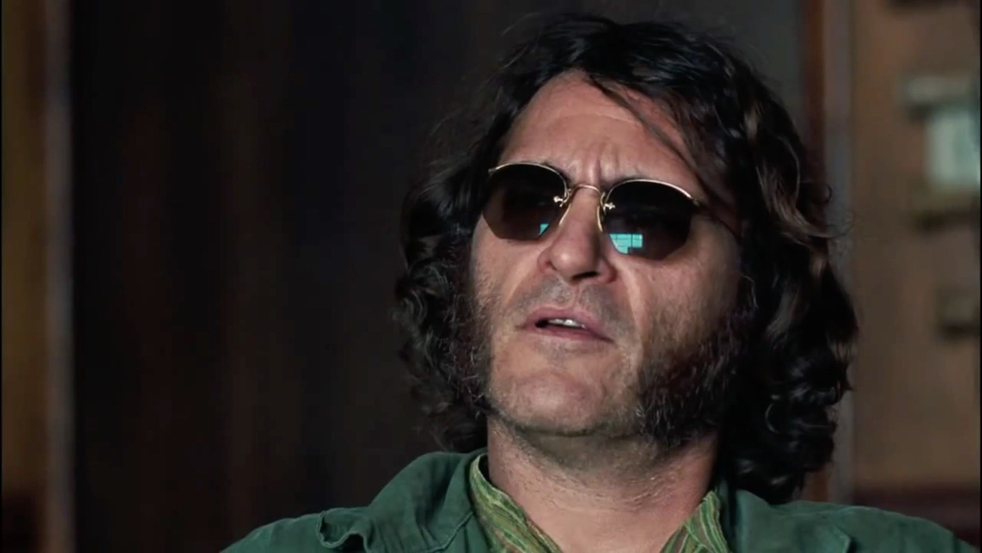 Joaquin Phoenix with Ray Ban Round Classic Sunglasses in