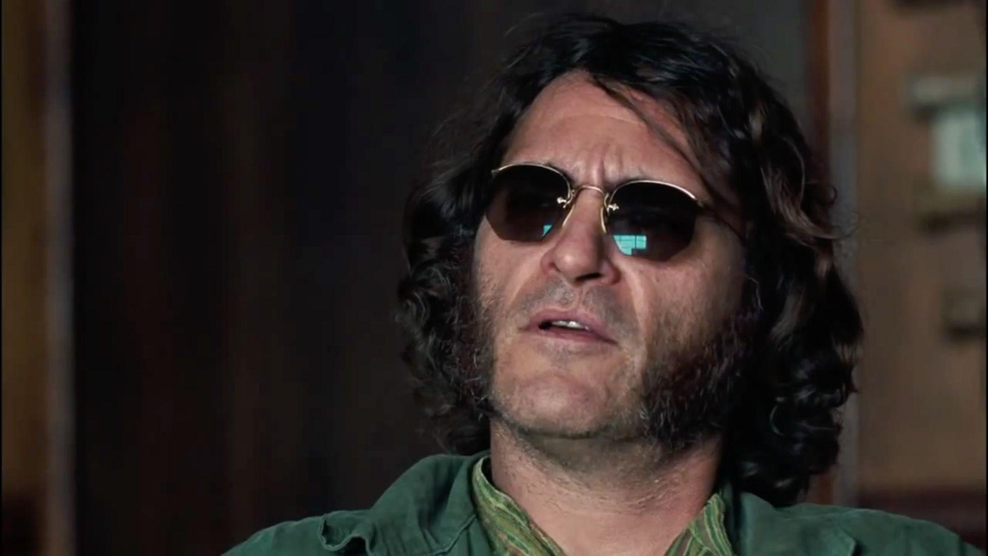 69b13bca95 Joaquin Phoenix with Ray-Ban Round Classic Sunglasses in Inherent Vice