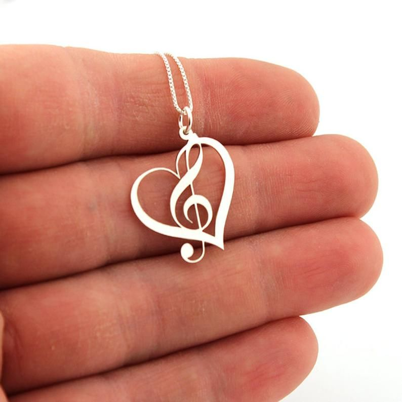 Large rhinestone treble clef music note pendant silver tone crystal necklace
