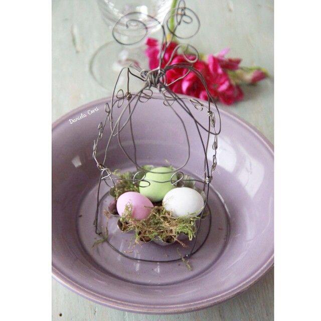 Decor ideas for Easter table , a wire cloche wirh chocolate eggs   By Fili di poesia