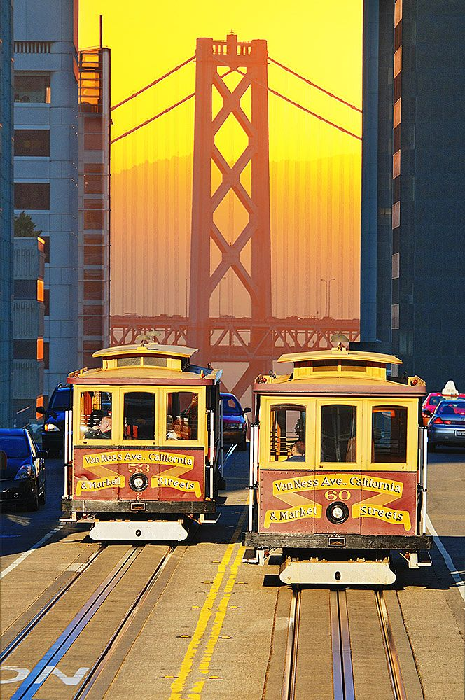 Cable Cars At Sunrise With Bay Bridge In Background San Francisco