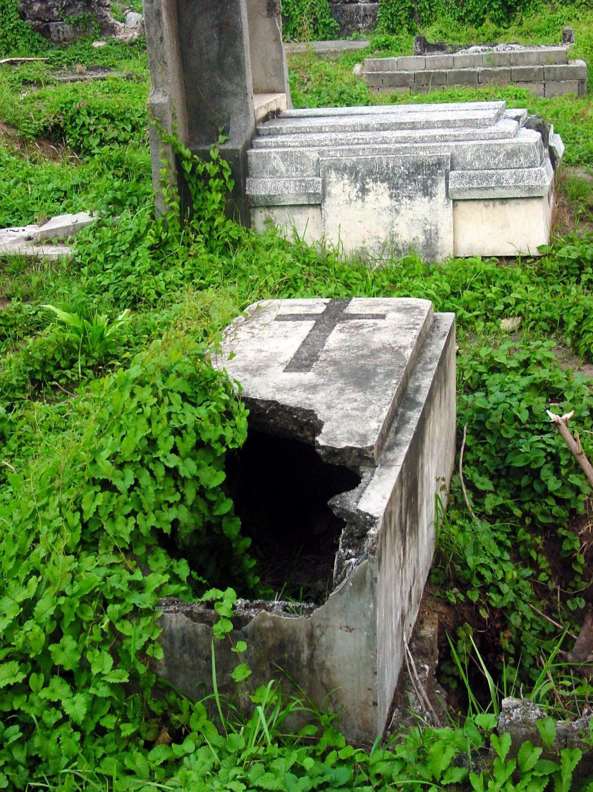 What could falling into an open grave mean cemeteries