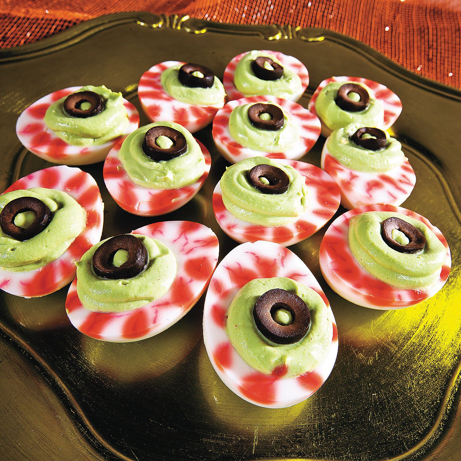 Deviled+Egg+Eyeballs use red food coloring to draw the