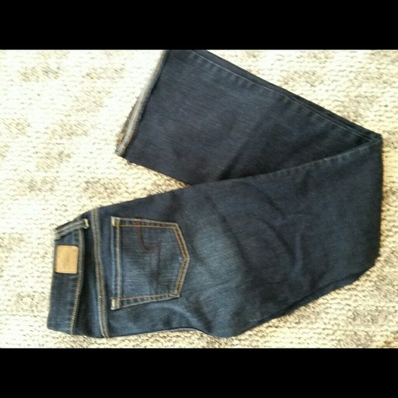 American eagle artist jeans Super stretch AE denim. The artist has a slightly wider leg at the bottom, but not a flare. Very flattering jeans. American Eagle Outfitters Jeans