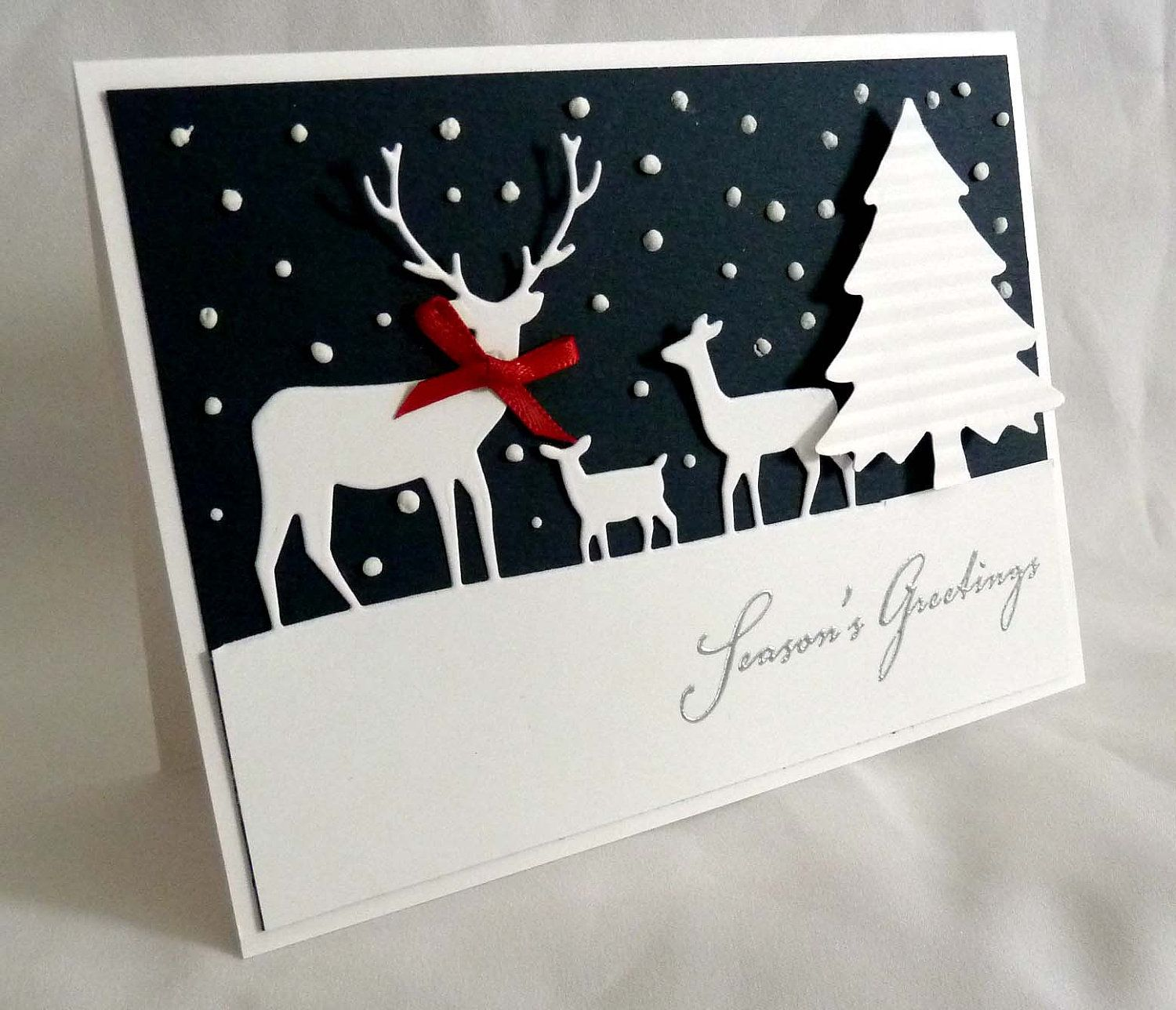Handmade christmas card black and white die cut deer and tree white polka dots on black background graphic look