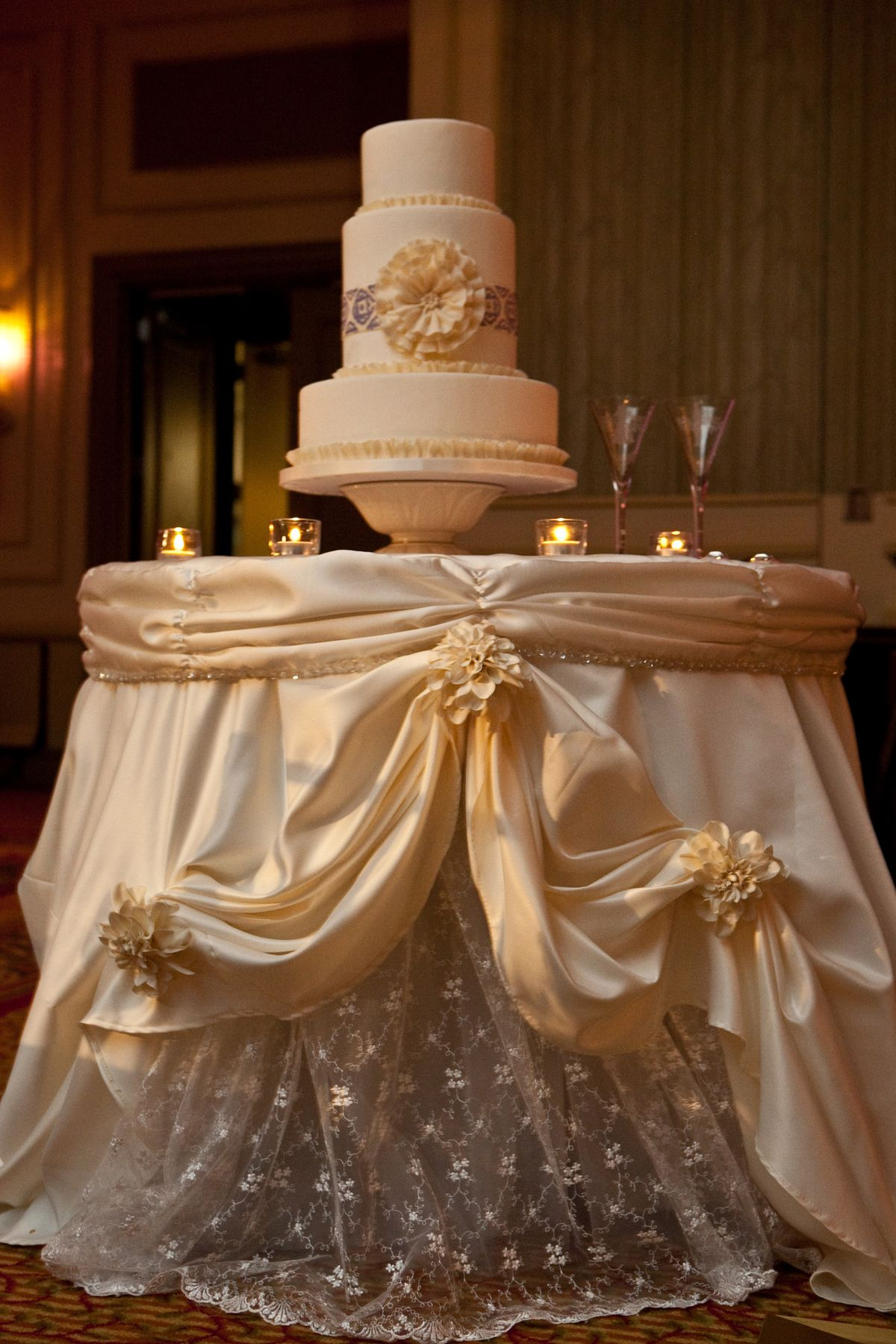 The gorgeous cake table linen was made to resemble the ...