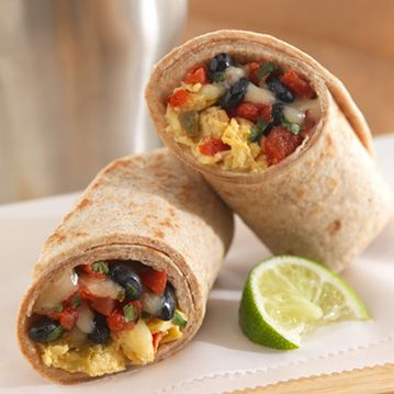 Piping hot Southwestern Egg Beaters, black beans and tomato topped with spicy cheese and cilantro wrapped in a warm whole wheat tortilla