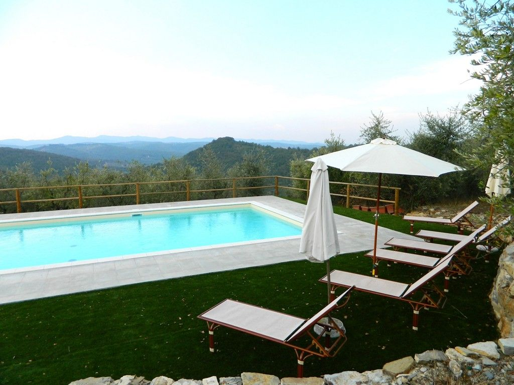 Wonderful view of the swimming pool equipped with chaise-longues