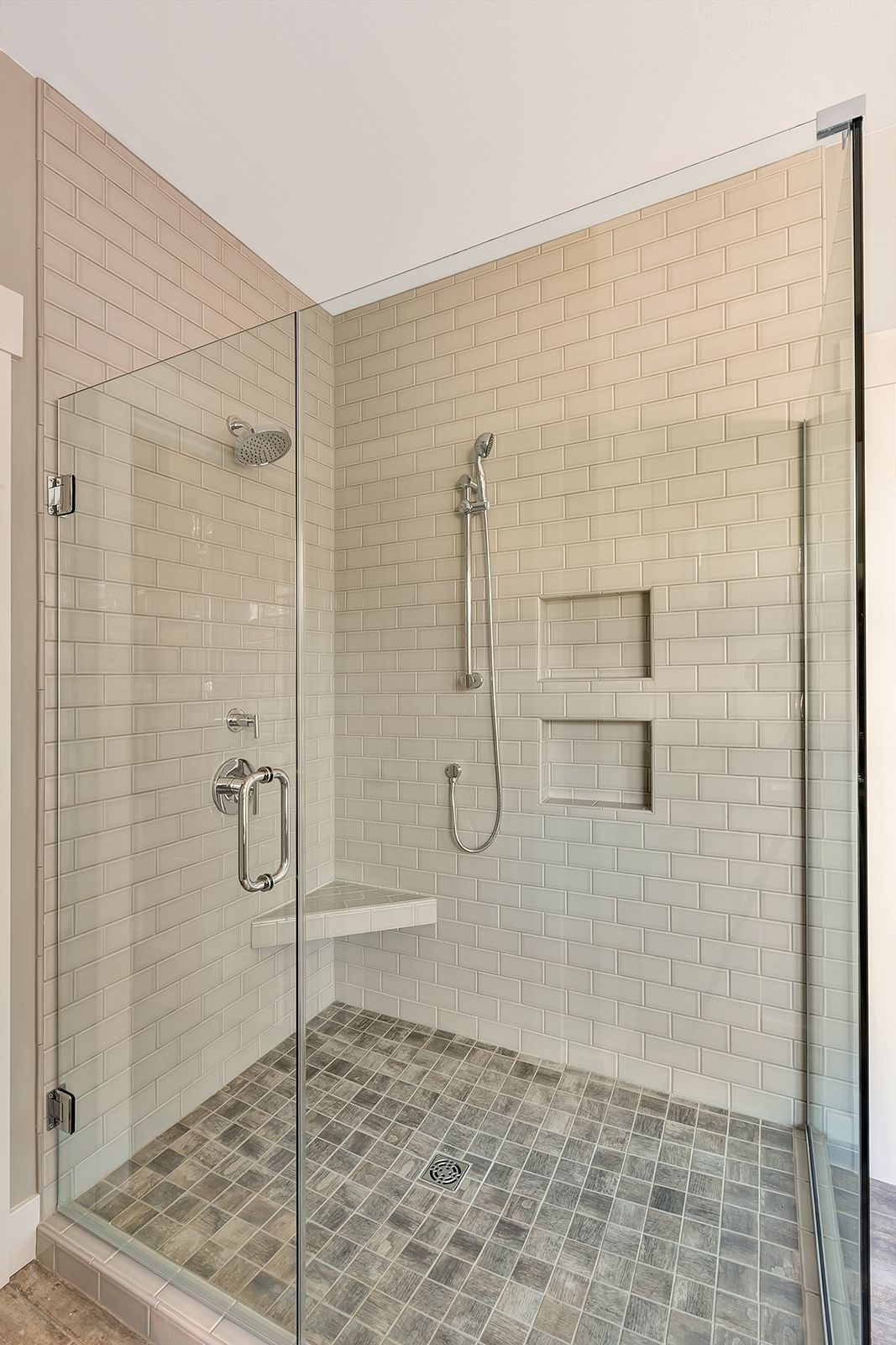 Walk in master shower with fully tiled shower walls and for Master bathroom glass doors