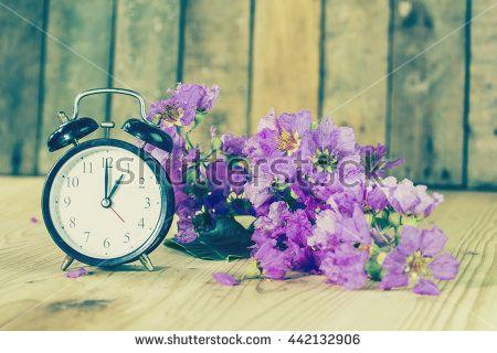 Alarm clock on a wooden table. Still life Style Vintage. - stock photo