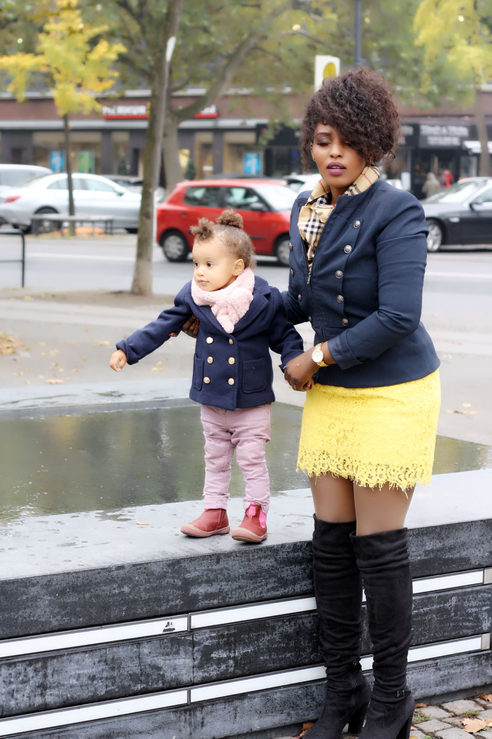 Dress a baby in clothes that look like mini down versions of adult