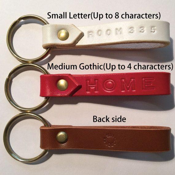 Gepersonaliseerde Lederen sleutelhanger met de ring en de
