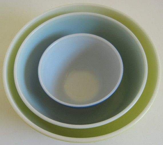 Youve found vintage Pyrex primary color mixing bowl 404 and 403! Choose large yellow mixing bowl or medium large green mixing bowl: Details: Yellow: Marked 404 Trade Mark 1, Pyrex, Made in USA, Ovenware, this large yellow Pyrex mixing bowl from the primary color mixing bowl set is chip- and crack-free. It has loss of gloss / rub marks on the lower 2/3 of the bowl from stacking and minimal gray marks to the exterior. The interior of this yellow Pyrex mixing bowl has some utensil mark...