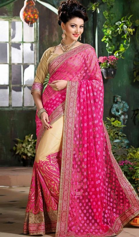 Make a striking entrance by sporting this pink and beige shade brasso net saree. This charming attire is displaying some extraordinary embroidery done with butta, lace, resham and stones work. #RosePinkAndBeigeHalfAndHalfBrassoSari