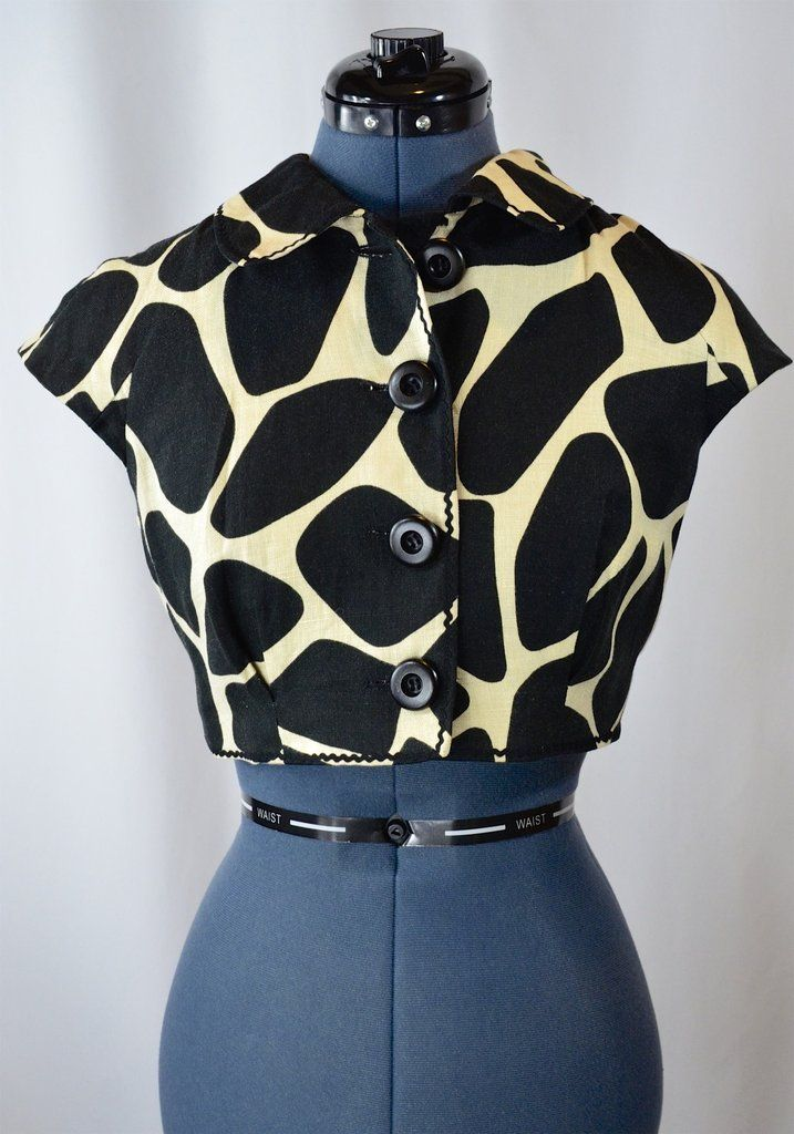 Moschino Black and White jacket. Very avant garde, place this fun cropped jacket on top of any LBD.