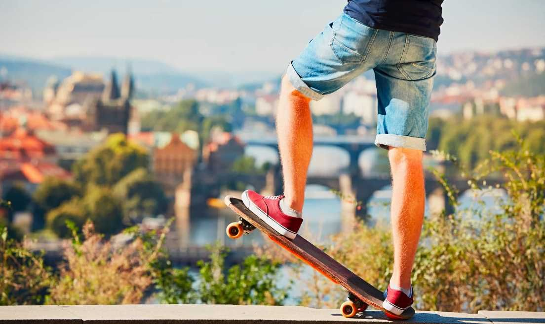Young skateboarder is riding on the skateboard in the city
