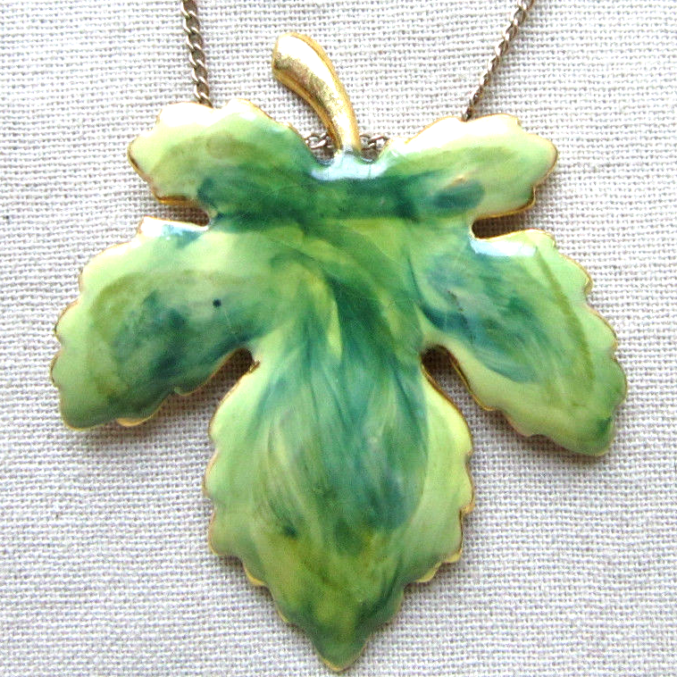 Wonderful .  This vintage enamel leaf pendant measures approx. 2, the chain measures approx. 18 and is marked 1/20 12 kt. This is a beautifully crafted necklace, ...