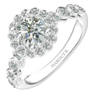 Engagement Ring With 4 Prong Round Center Stone Encircled By A Single Row. from Vanscoydiamonds.com