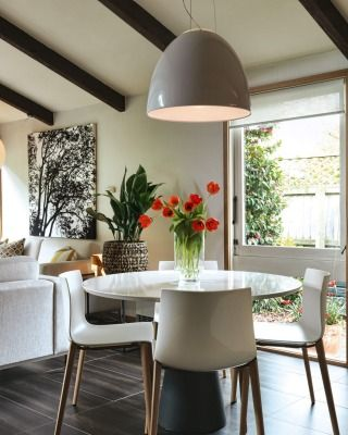 In The Kitchen Dining Area An Artemide Nur Gloss Pendant Hangs Over Andreu