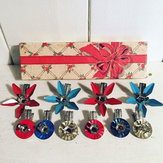 A lovely 1950s set of enamel clip on Christmas tree candle holders