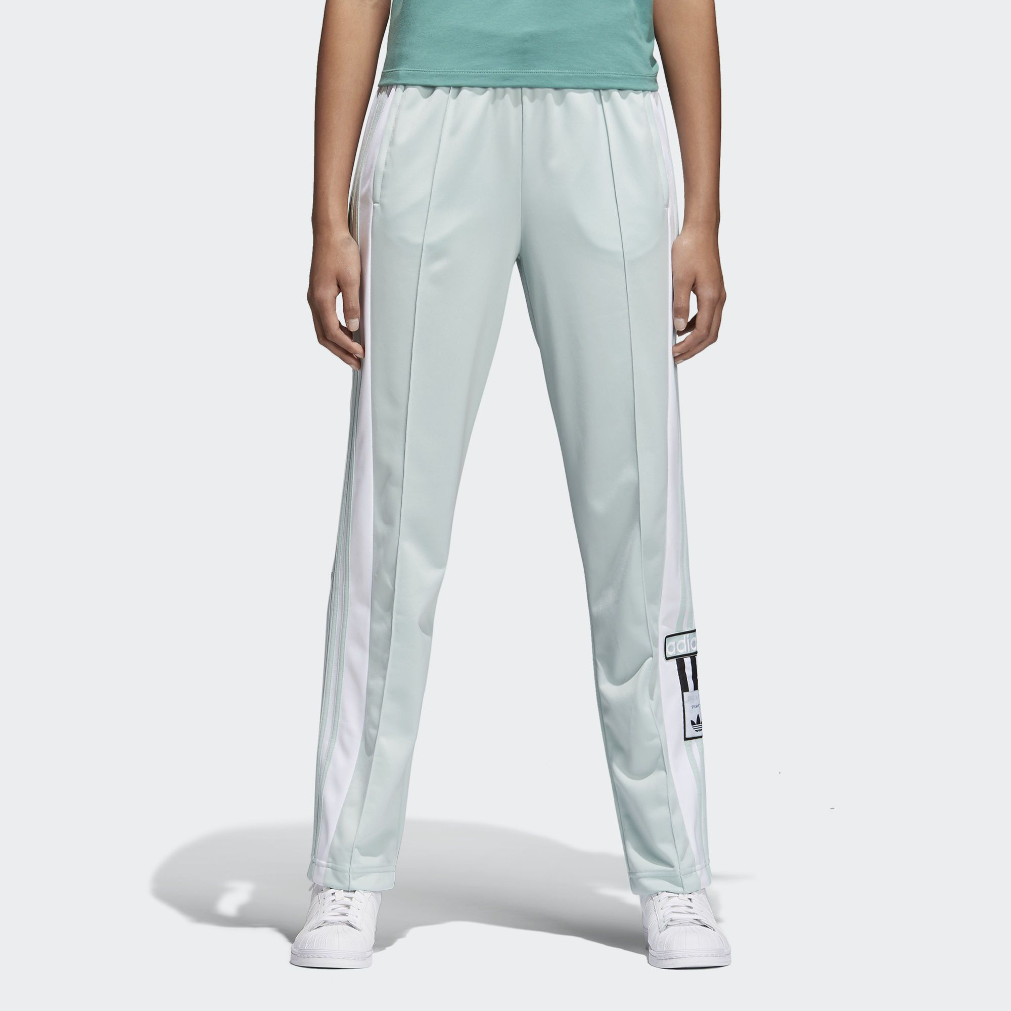 c5635a34977 Recognizable 3-Stripes down the sides of these women's track pants keep the  modern look pulsing with adidas heritage. Bringing back an iconic style, ...