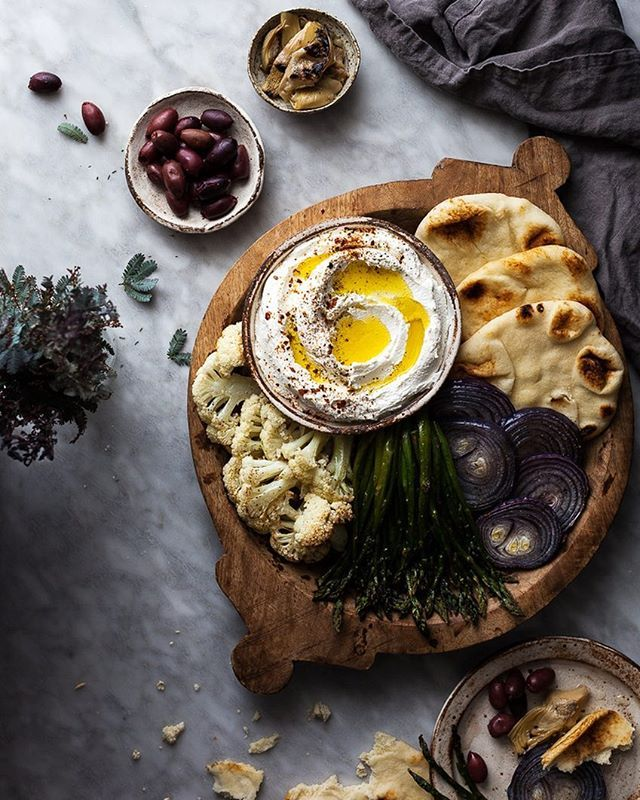 Now this is my kind of party food - a Labneh Platter packed with roasted veggies, flatbread, and olives! Labneh is a thick spreadable cheese made from yogurt. I used @chobani 's Plain Whole Milk Greek Yogurt to make an incredibly rich and creamy labneh and served it with roasted cauliflower steaks, Asparagus, red onion, flatbreads, Kalamata olives, and marinated artichoke hearts. Recipe below! #chobani #chosquad #sponsored To make the Labneh: 32 ounces (one container) Chobani Whole Milk Gre...