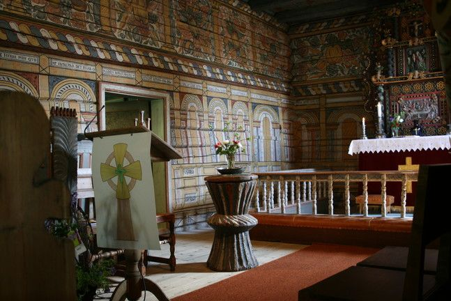 Inside of Rollag stav church, with baptismal font from 1300s, Norway