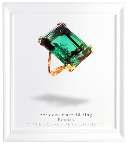 18 carats gold ring with a fabulous emerald doublet