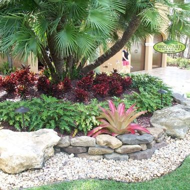 Outdoor Design Ideas Pictures Remodels And Decor Houzz Front Yard Landscaping Design Tropical Landscaping Landscaping With Rocks