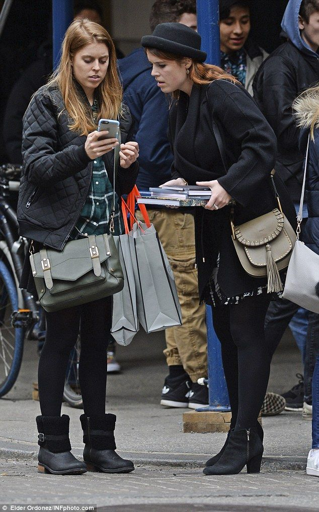 Lost? Beatrice and Eugenie look disorientated shopping in