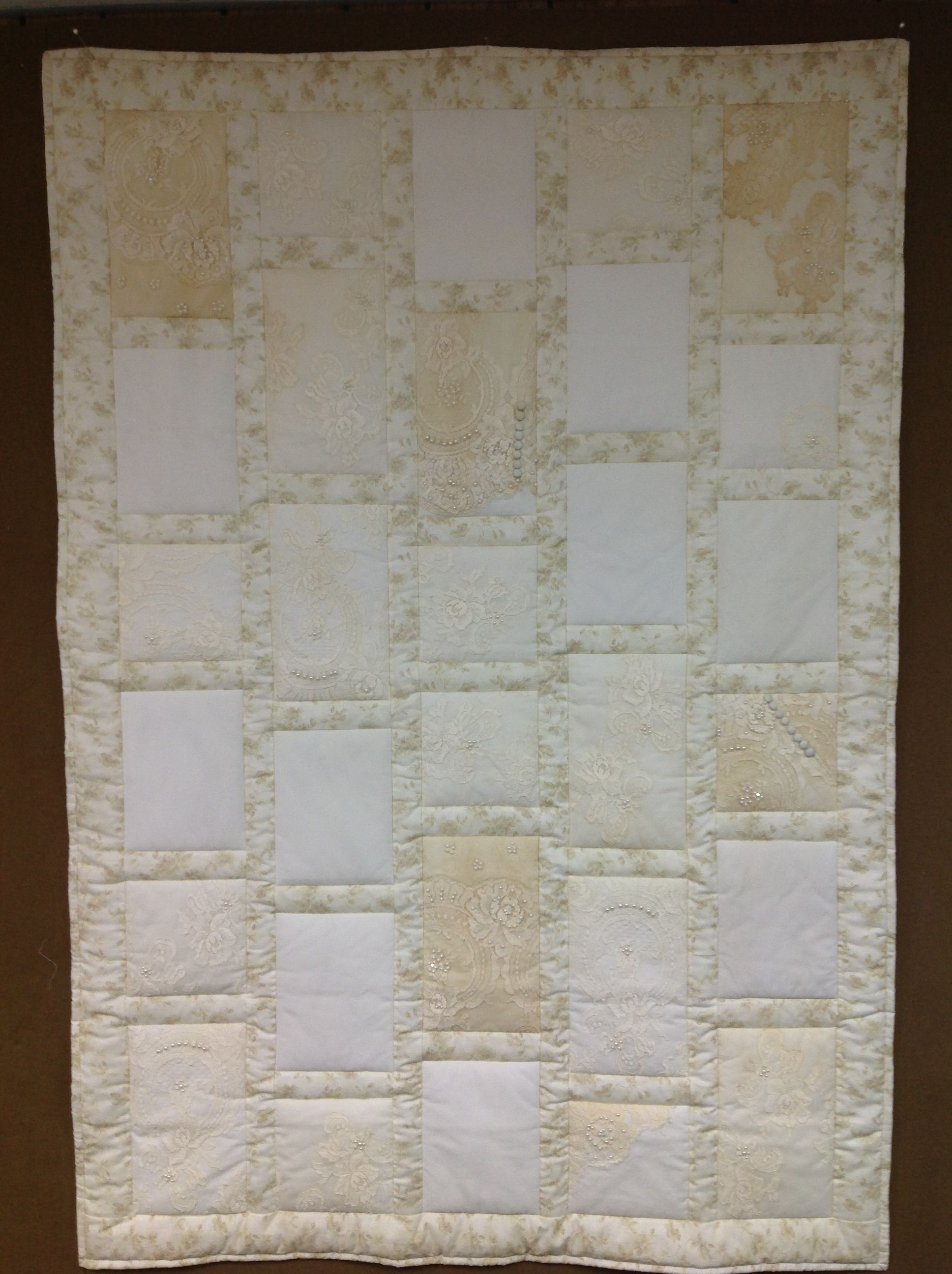Quilt made with wedding dresses.