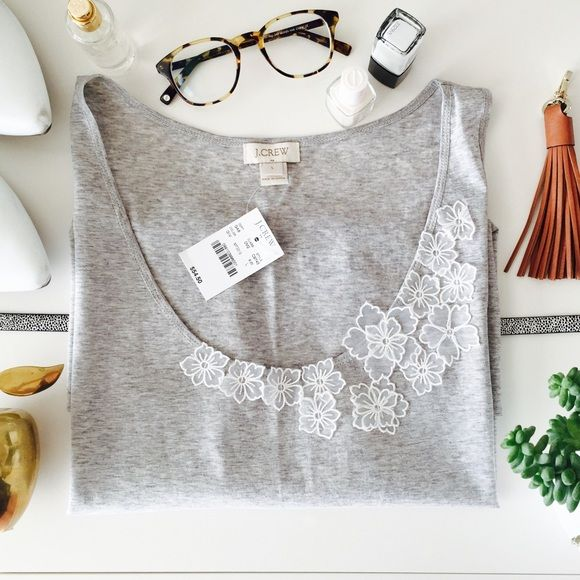 """J. Crew   Gray & Ivory Floral Detailed Tank Top  DO NOT USE THE OFFER BUTTON! NO OFFERS WILL BE ACCEPTED. FINAL PRICE ITEM.  J. Crew   This gorgeous gray scoop neck tank top is a staple in every wardrobe. With a cute set of cascading ivory embroidered lace flowers at the neckline and a """"oh-so-soft"""" fabric, wear this top running errands or out for drinks with friends. It's completely versatile. This top is brand new with tags and comes from a smoke free home. Photo credit: jcrew.com J. Crew…"""