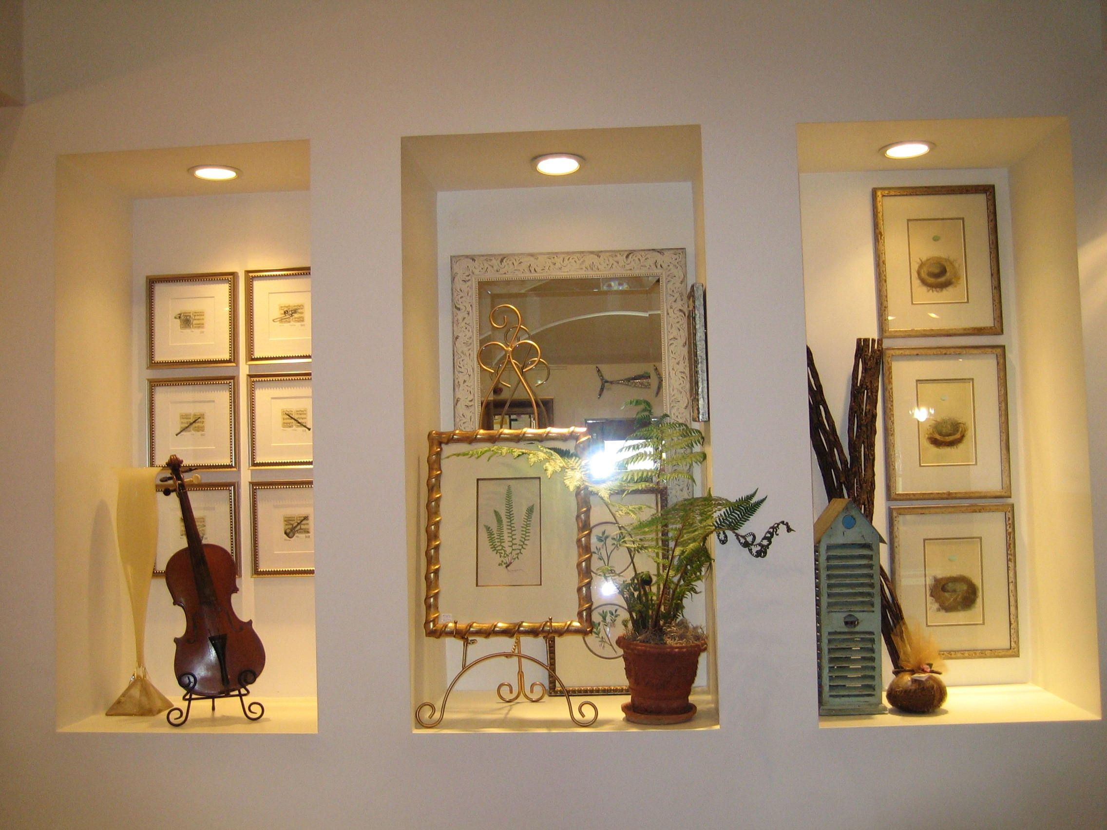 I love this idea of niche displays for antiques, statue, or beautif ...
