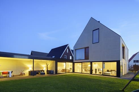 vrijstaand woonhuis particulier: moderne Woonkamer door JMW architecten