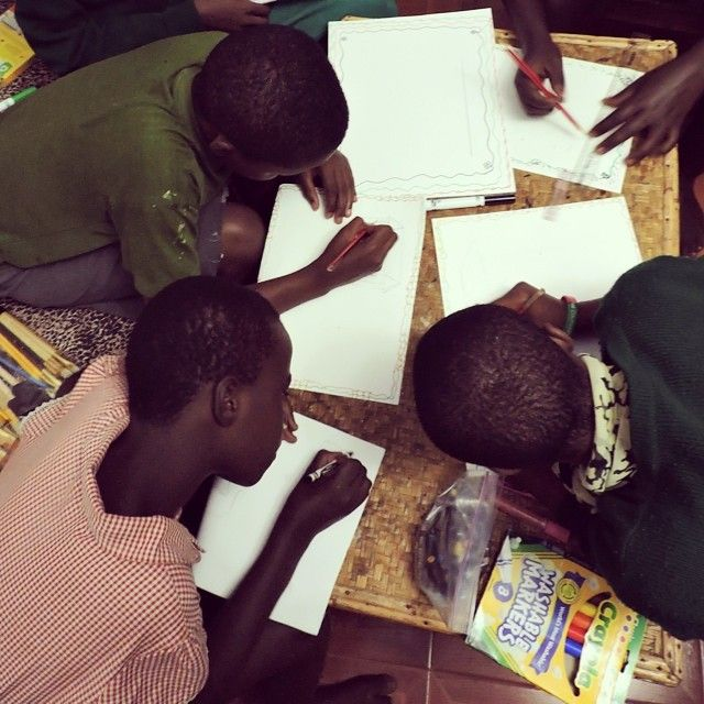Girls in the Mengo Home in Uganda enjoying art supplies from HALO.