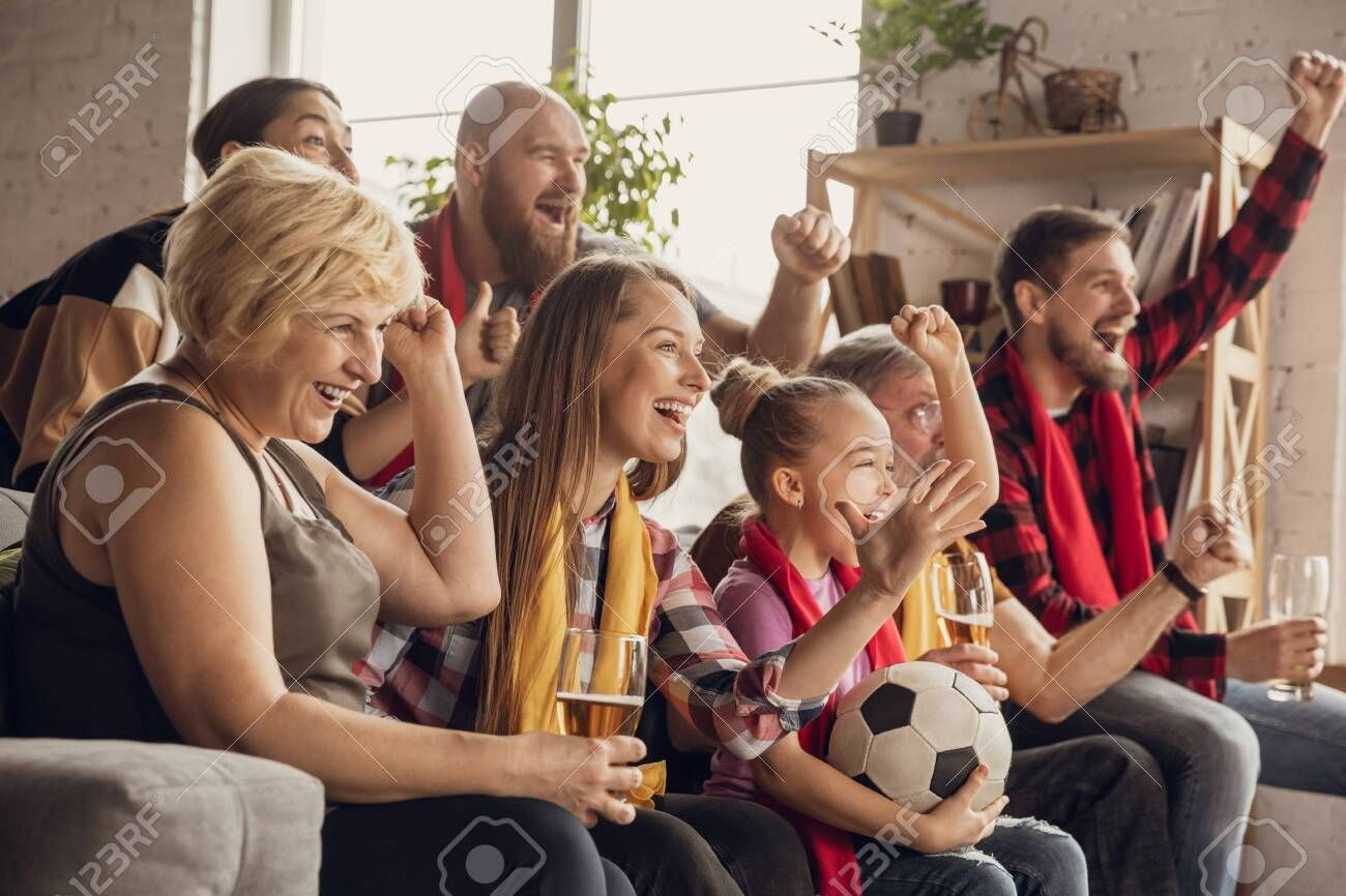 Excited Happy Big Family Watching Football Soccer Match On The Couch At Home Fans Emotional Cheering For Favourite National T In 2020 Soccer Match Big Family Soccer