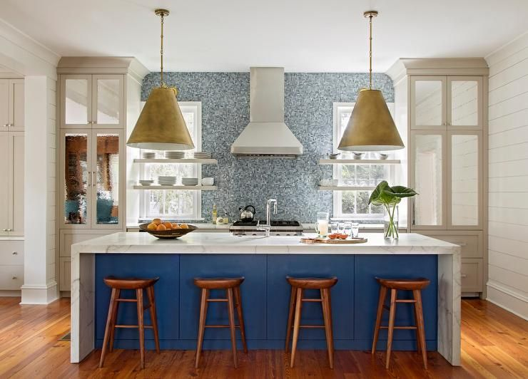 beautiful blue kitchen is lit by goodman hanging lamps hung over a blue center island seating wo on kitchen decor blue id=25496