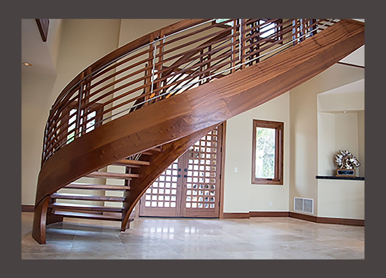 Backside View Of Curved Floating Sapele And Stainless Steel Stair   Custom  Designed By NK Woodworking