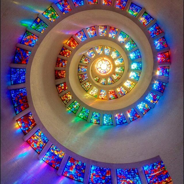The phi in stained glass. Beautiful reflection of the grand architect.