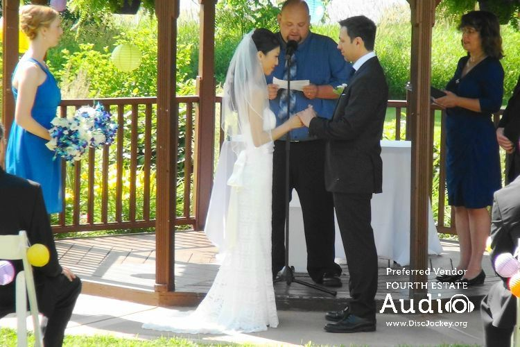 A happy couple begins a new life together under the gazebo at Riverview Banquets in Batavia. http://www.discjockey.org