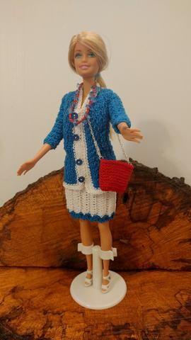 Barbie is wearing her 3 piece suit. The suit is made in a sage green color. The blouse is made in a variegated color. She has matching shoes, panties, jewelry to complete the outfit. Barbie Beach doll