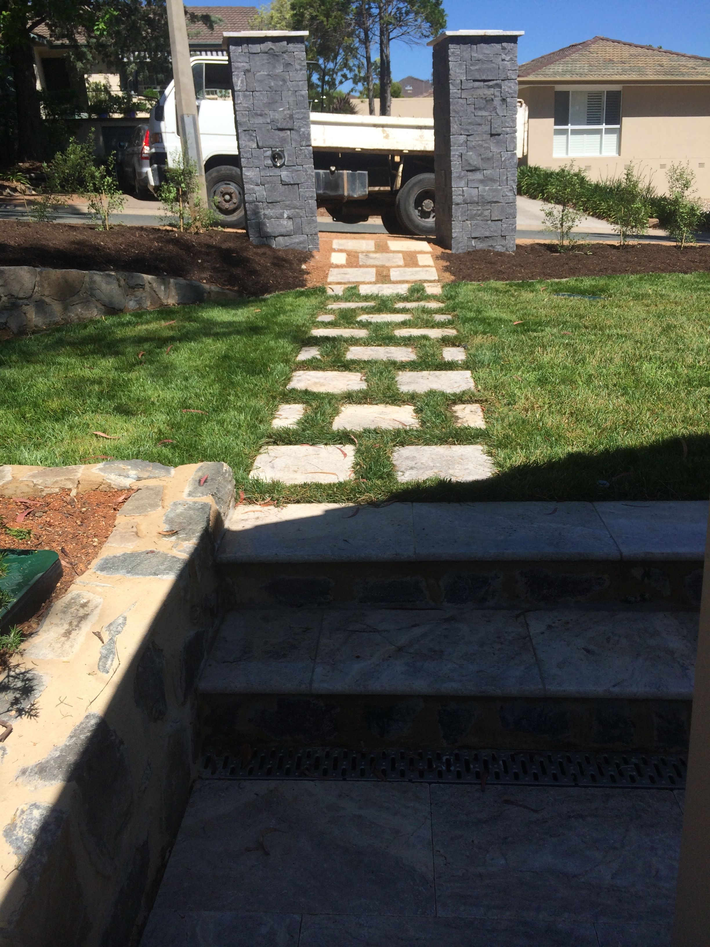 Front yard steps stepping stone path stone letter box for Rock stepping stones landscaping