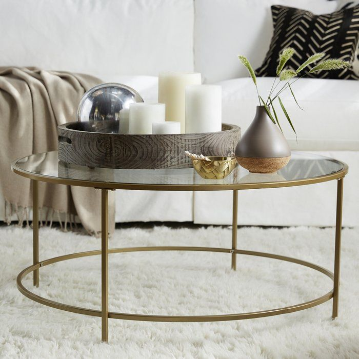 An Elegant Centerpiece For Your Living Room This Chic Coffee Table Showcases An Openwork Base And Slee Glass Coffee Table Decor Chic Coffee Table Coffee Table