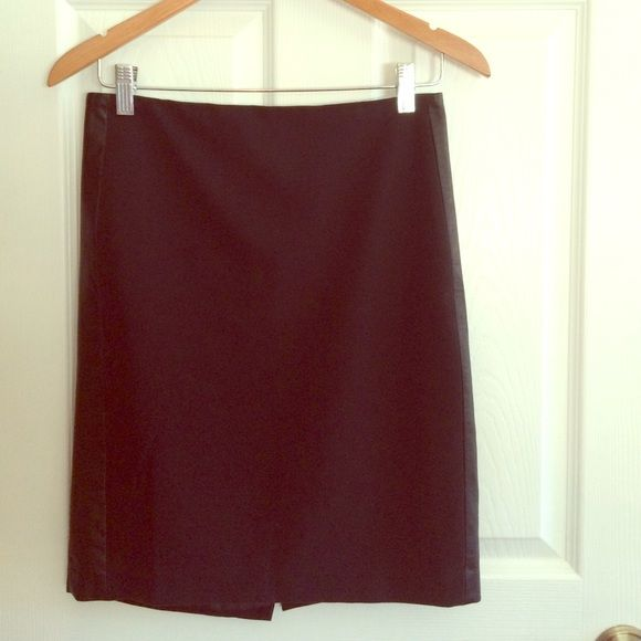 DKNY pencil skirt with leather side strip Awesome black pencil skirt with a strip of faux leather on either side. Worn, but in great condition! Sizing says 0 but fits more like a 2. Very fun and comfortable, looks hot on! DKNY Skirts Pencil