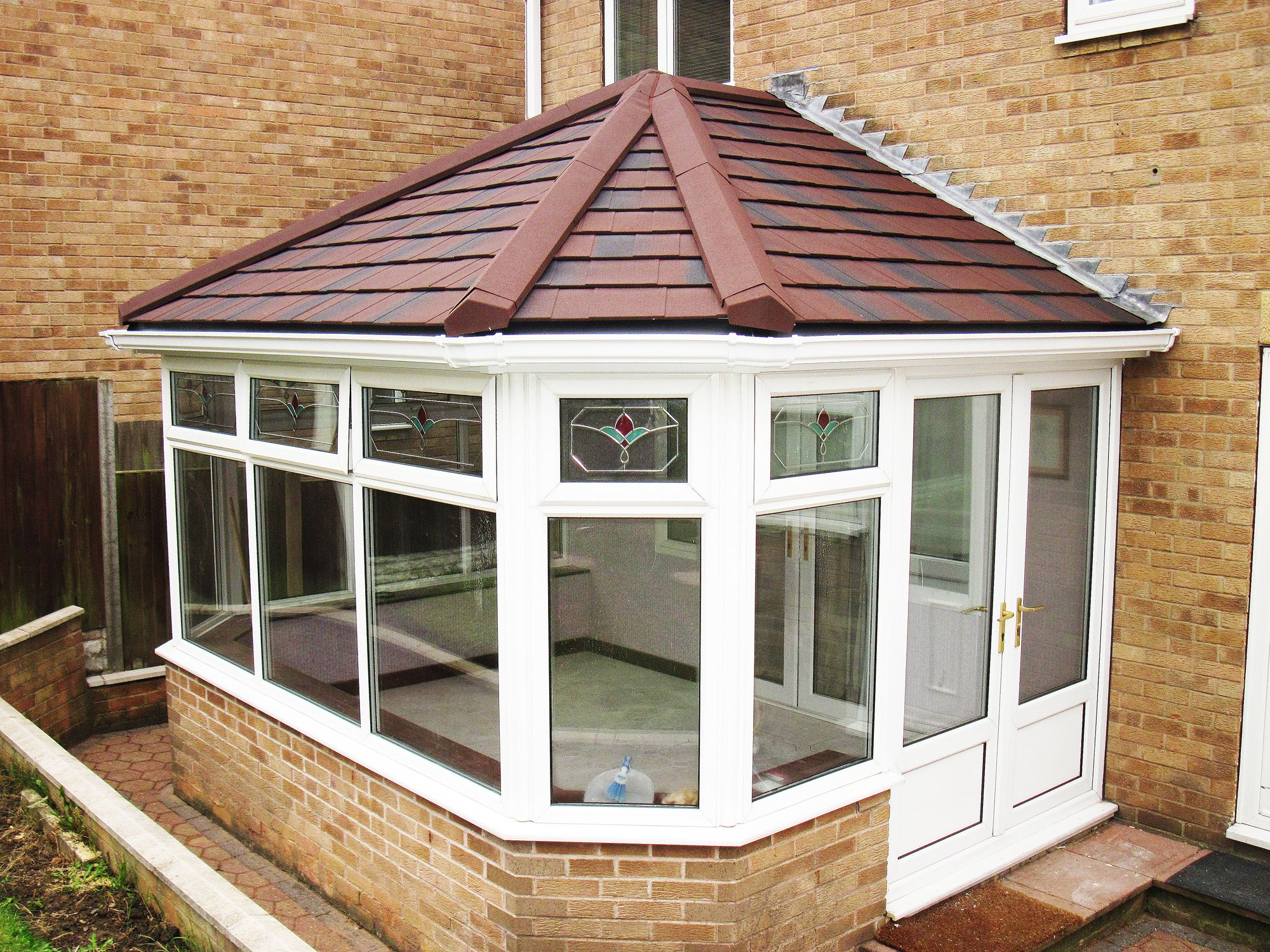 Supalite Tiled Conservatory Roofing System With Burnt Umber Metrotiles Finished Off With White Gutt Tiled Conservatory Roof Roofing Systems Conservatory Roof
